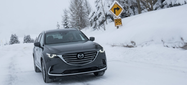 2018 Mazda CX-9 gray front view in snow AWD