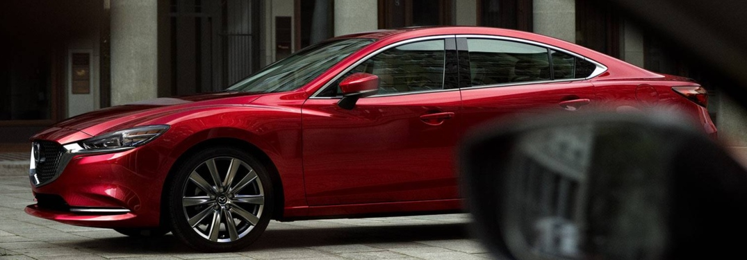 2018 Mazda6 red side view through another car's side window