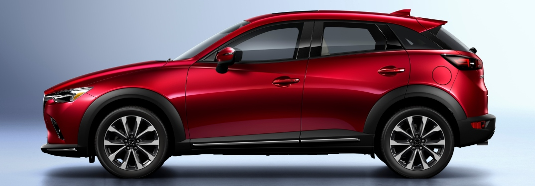 What does the Grand Touring trim add for the Mazda CX-3?