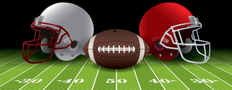 Football helmets and ball on a field