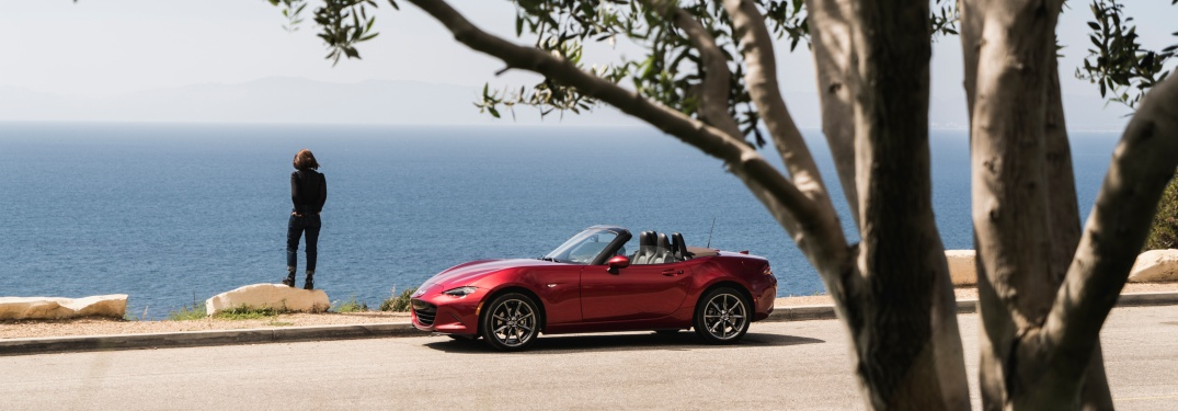 2019 Mazda MX-5 Maita red side view at a large body of water