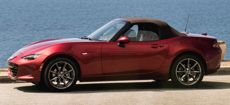 2019 Mazda MX-5 Miata red side view with a brown top