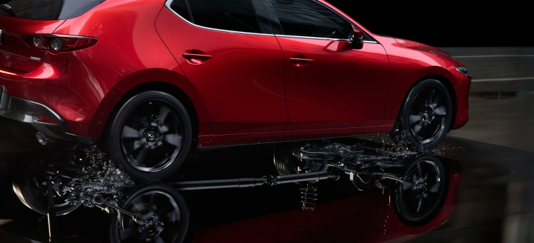 2019 Mazda3 AWD in water red side view