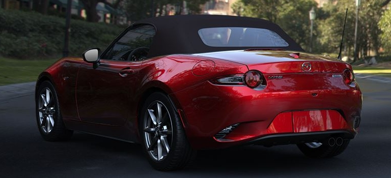 2019 Mazda MX-5 Miata red back view with brown top