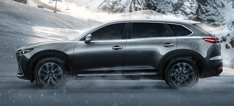 2019 Mazda CX-9 gray side view in the snow