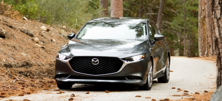 2019 Mazda3 sedan gray front view in the woods