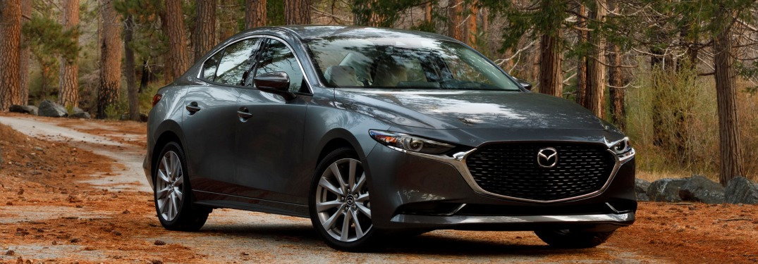 2019 Mazda3 sedan gray side view in the woods