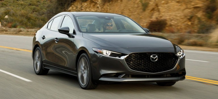 2019 Mazda3 Sedan gray front view on a mountain road
