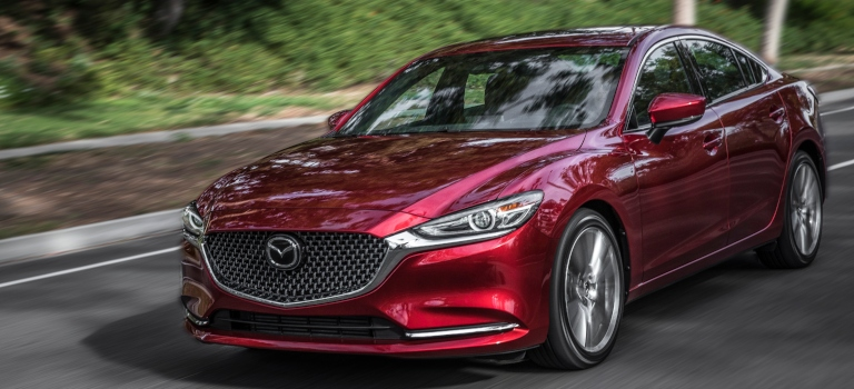 2018 Mazda6 red front side view on the road