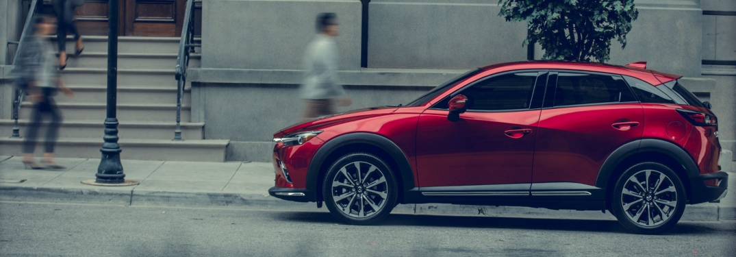 2019 Mazda CX-3 red side view in the city