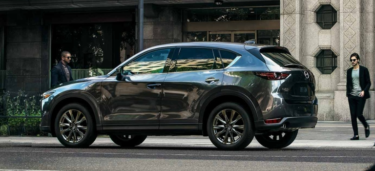 2019 Mazda CX-5 gray side view in the city