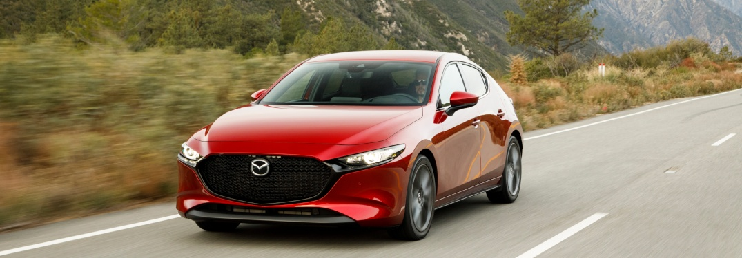 2019 Mazda3 Hatchback red front view on the road