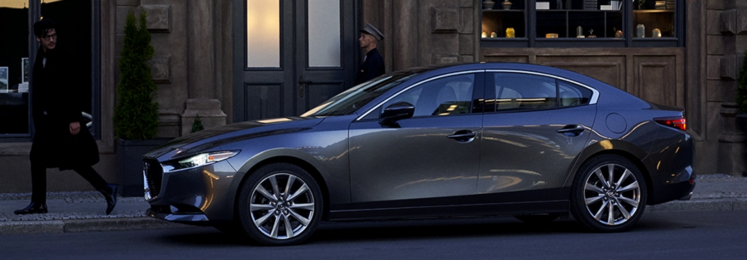 2019 Mazda3 Sedan gray side view in the city