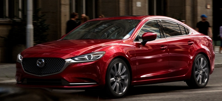 2019 Mazda6 red front side view in the city