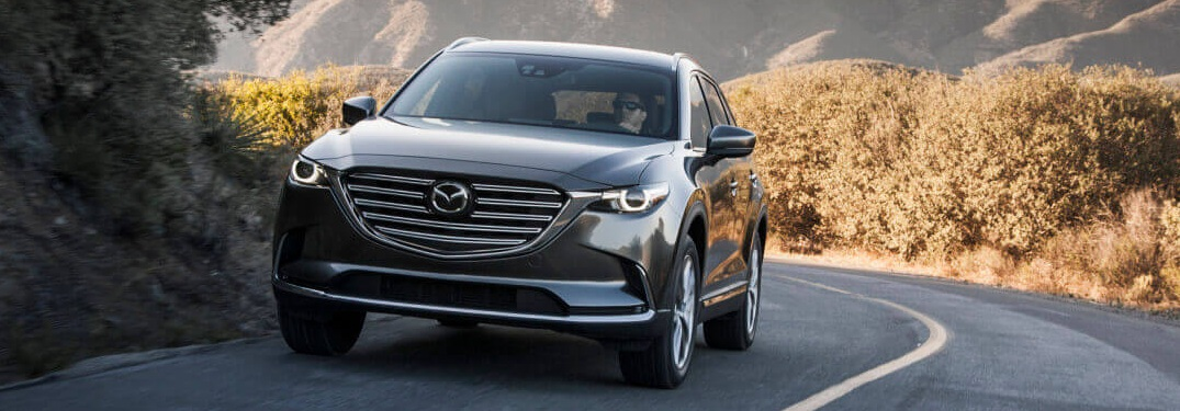 2019 Mazda CX-9 gray front view driving up a mountain road