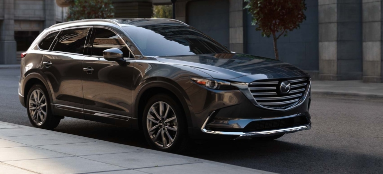 2019 Mazda CX-9 gray side view parked on the road