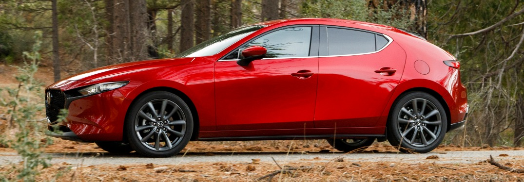 2019 Mazda3 Hatchbakc red side view in pine brush