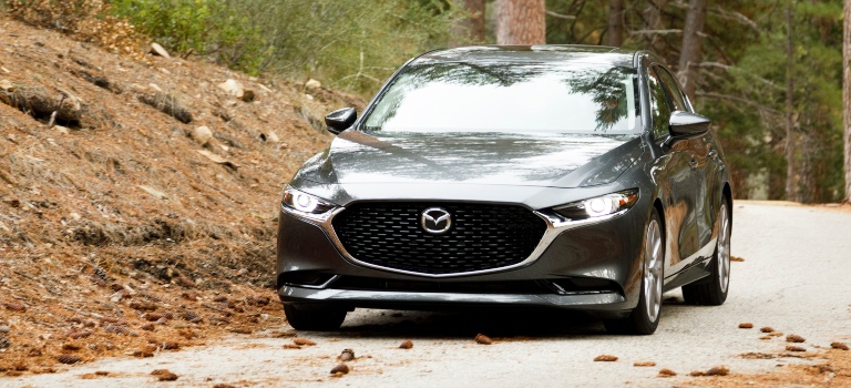 2019 Mazda3 gray front view in the trees