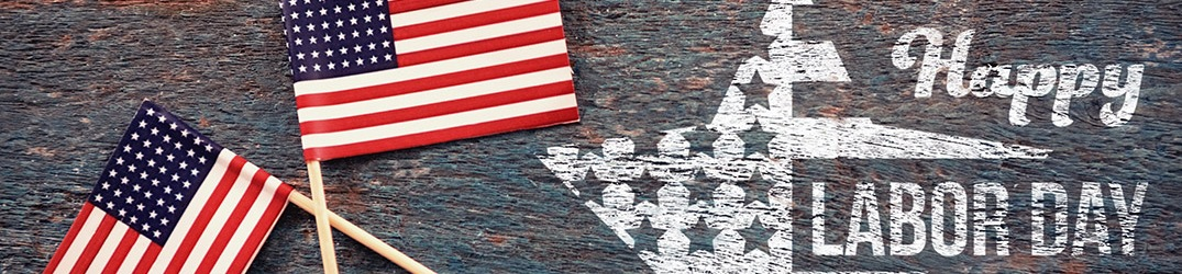 Happy Labor Day on a background with small American flags