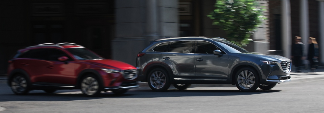 2019 Mazda CX-3 and Mazda CX-9 gray and red side view