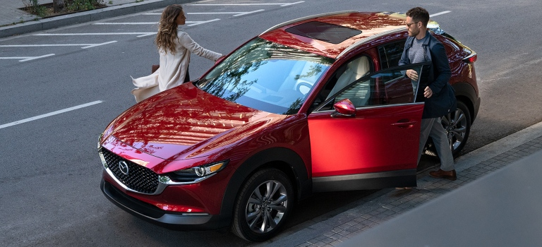 2020 Mazda CX-30 with man and a woman getting in