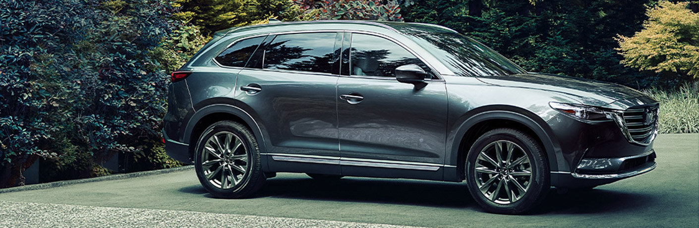 A gray 2020 Mazda CX-9 parked in the grass.