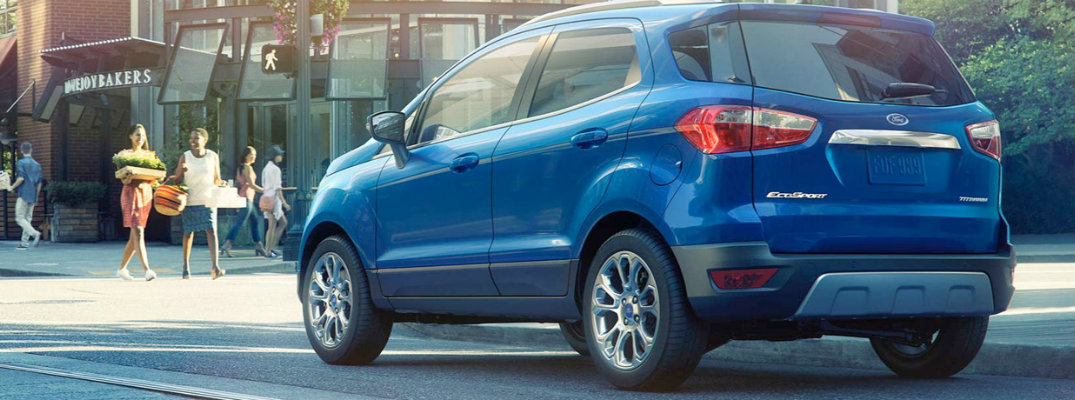 Blue 2018 Ford EcoSport driving through town