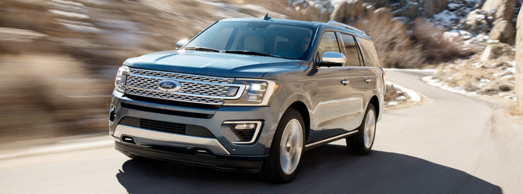 2018 Ford Expedition driving on a rural highway