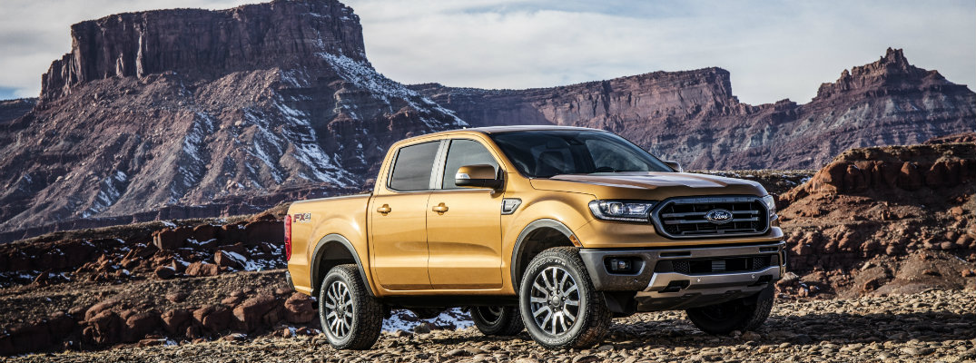 Gold-colored 2019 Ford Ranger parked in front of western-US landforms