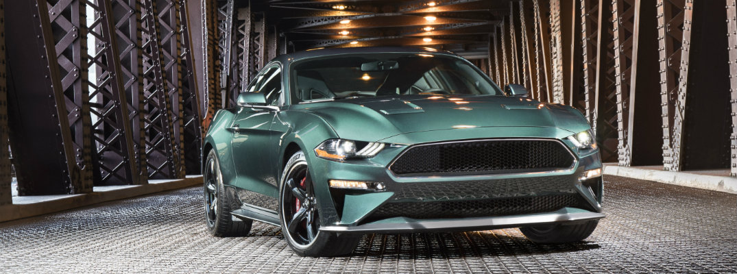 Green 2019 Ford Mustang BULLITT parked in industrial area