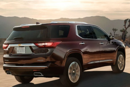 Rear view of a 2019 Chevy Traverse driving on open road