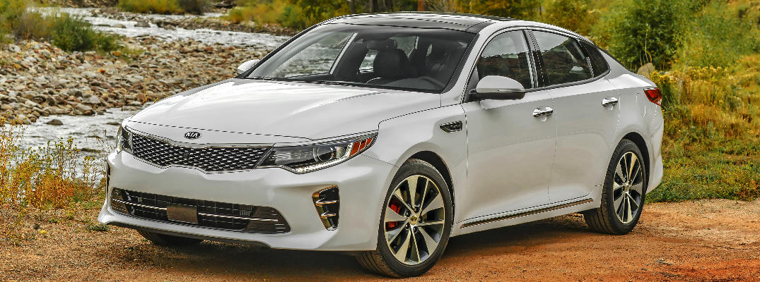 White 2017 Kia Optima Parked in Front of Creek