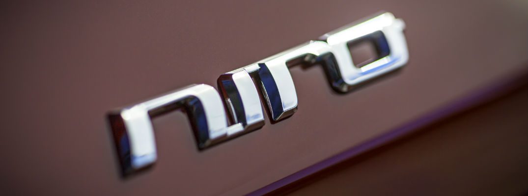 Close Up of Kia Niro badge on Maroon Exterior