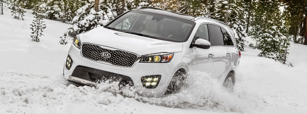 White 2017 Kia Sorento Driving Through the Snow