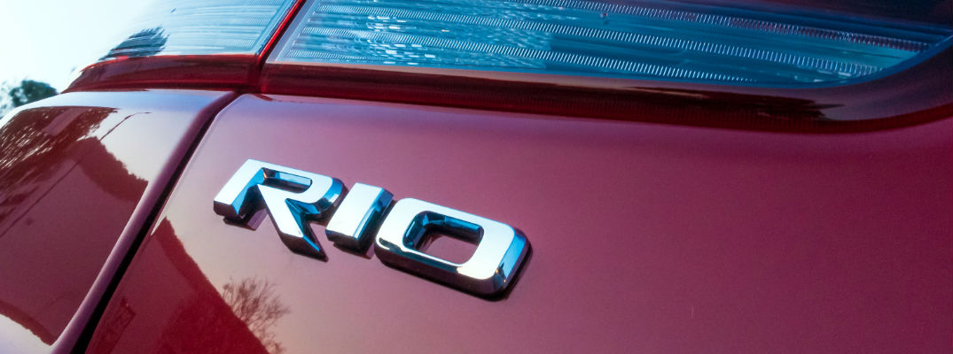 Close Up of 2018 Kia Rio Badge on Red Exterior