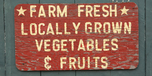 Red Farmers Market Sign with Locally-Grown Fruits and Vegetables on Gray Background