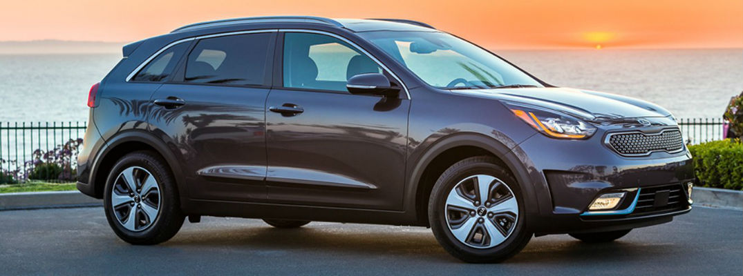 Sangria 2018 Kia Niro Plug-In Hybrid Exterior Next to Water at Sunset