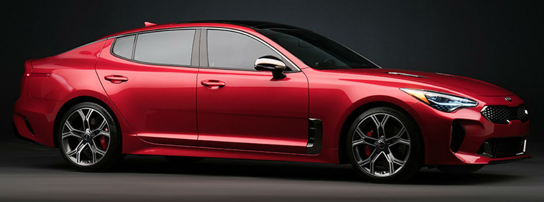 Red 2018 Kia Stinger Side Exterior on Dark Background