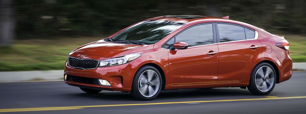 Red 2017 Kia Forte Driving on the Highway