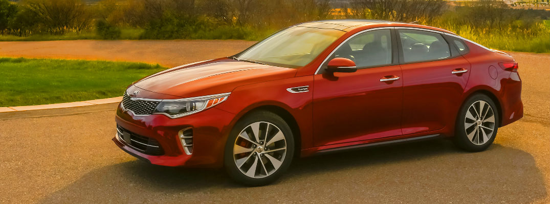 Red 2018 Kia Optima Side Exterior on Country Road