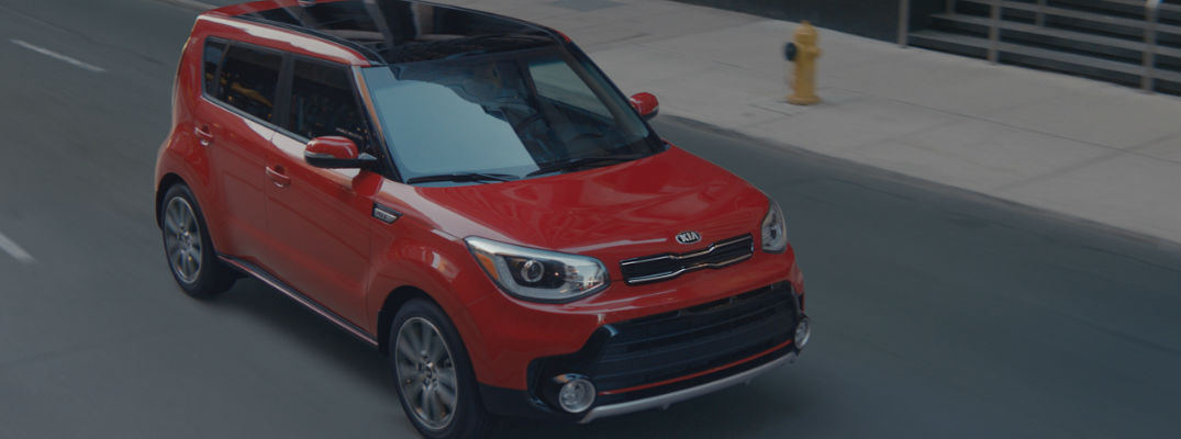 Red 2017 Kia Soul with Turbo Engine Driving on City Street