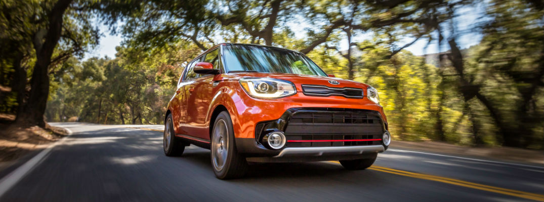 Orange 2018 Kia Soul on Wooded Country Road