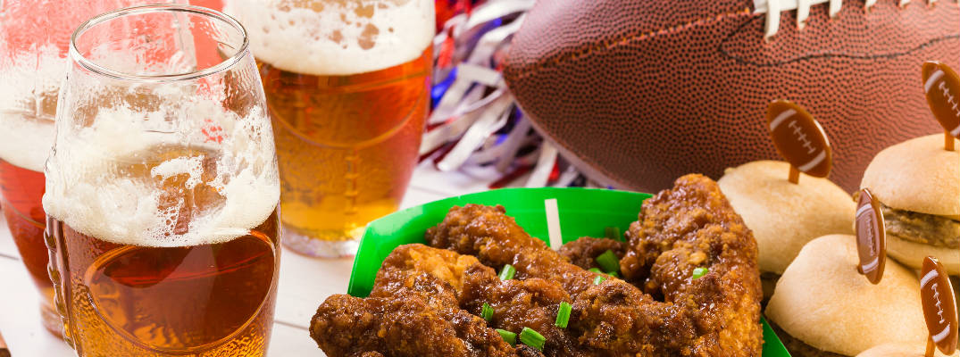 Beer, Wings, Cupcakes and a Football on a table at a fantasy football draft party