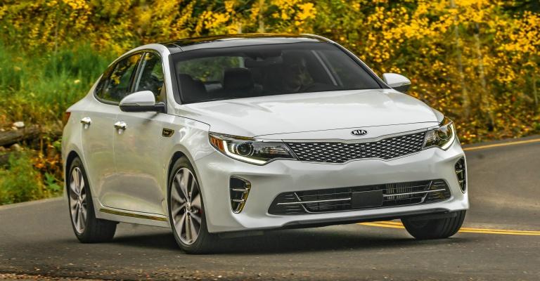 2018 Kia Optima white going fast around a curve