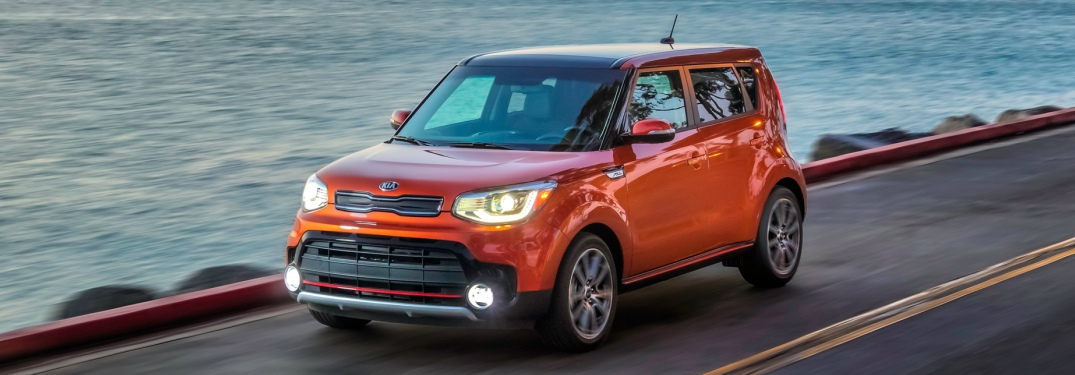 2018 Kia Soul orange driving on the coast front view