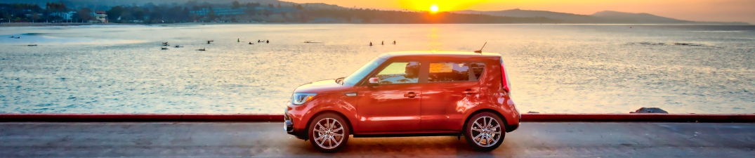 2018 Kia Soul orange side view at sunset