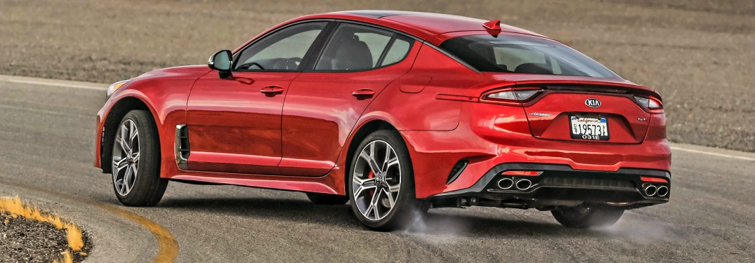 2018 Kia Stinger GT rear view wheels smoking in a corner