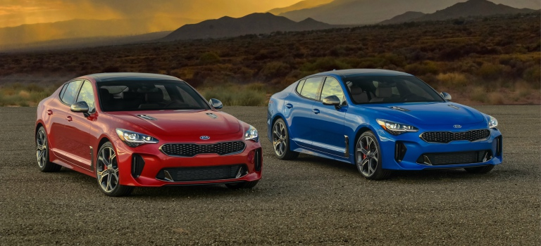 2018 Kia Stinger red and blue side by side front view
