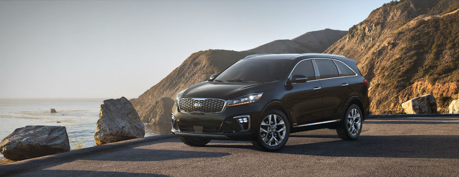black 2019 Kia Sorento exterior front fascia-and drivers side parked on cliff next to water