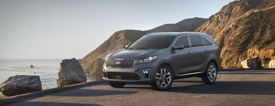 gray 2019 Kia Sorento exterior front fascia and drivers side on cliff with water